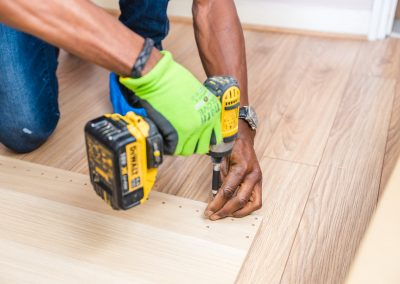 person-holding-dewalt-cordless-hand-drill-1249610